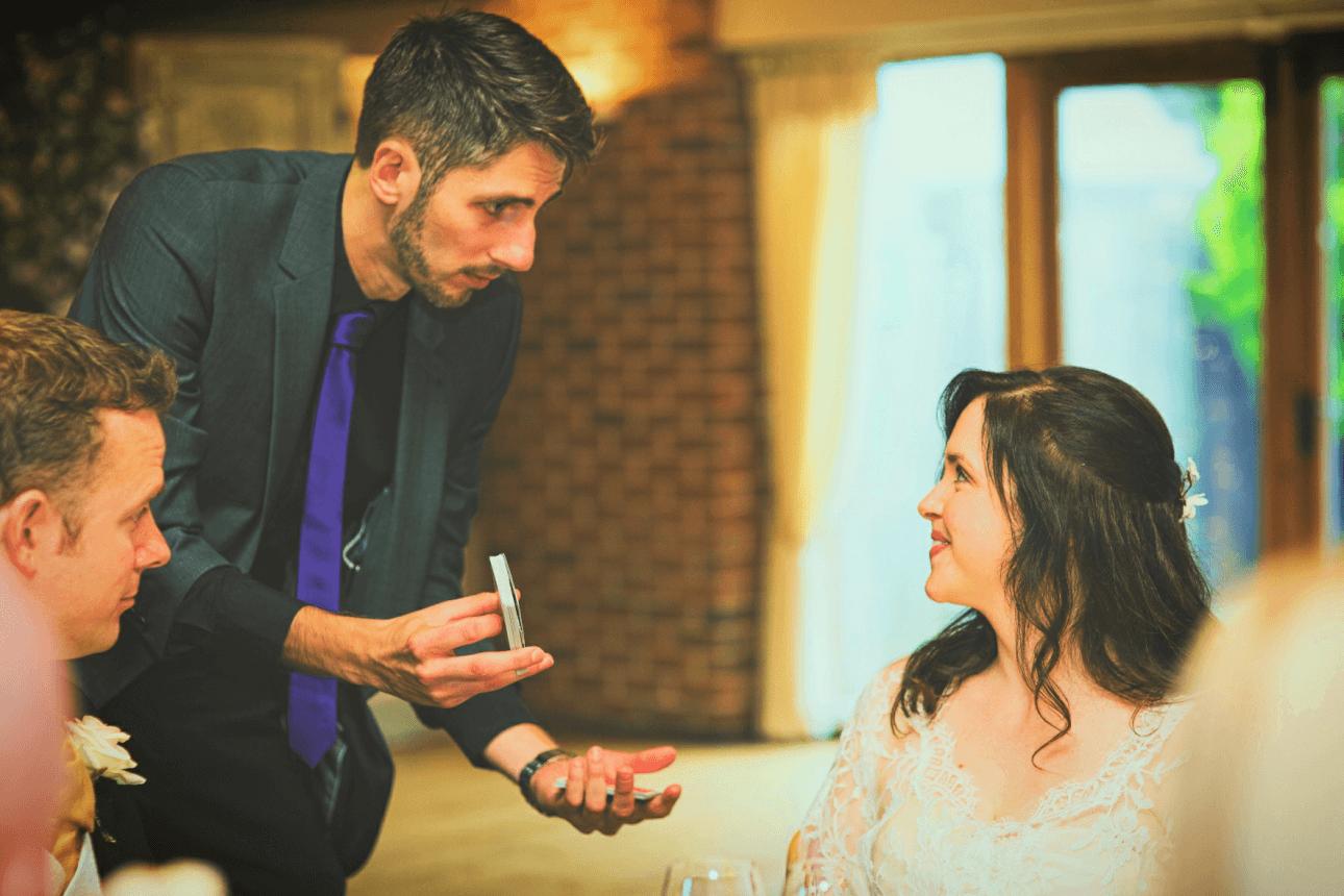 Wedding Magician Kev G performing Magic during the wedding breakfast